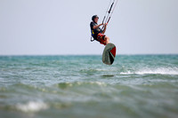 photograph of kiteboarder in mid-air.
